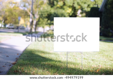 blank yard sign during sunny autumn weather