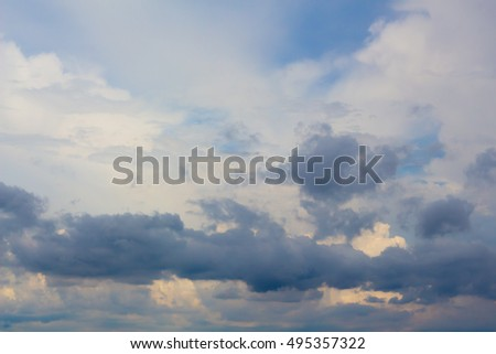 Blue sky with clouds drifting wide.  #495357322