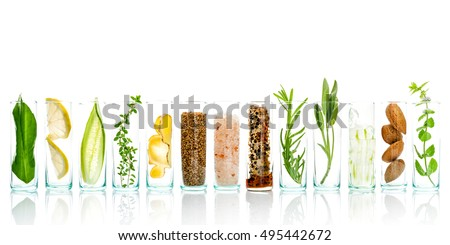 Homemade skin care with natural ingredients aloe vera, lemon, cucumber, himalayan salt, peppermint, rosemary, almonds, cucumber, ginger and honey pollen isolated on white background. Royalty-Free Stock Photo #495442672