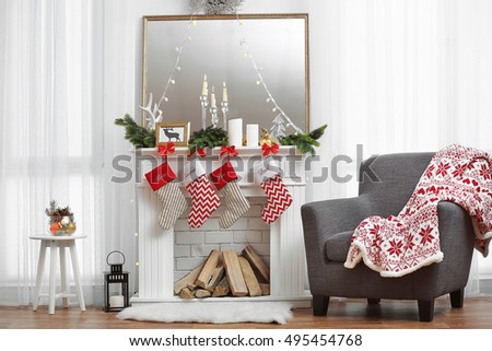 Living room with beautiful fireplace decorated for Christmas
