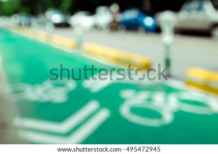 Blur image of bicycle sign on the green road #495472945