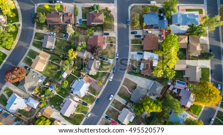 Aerial view of residential neighborhood in the Autumn. Royalty-Free Stock Photo #495520579