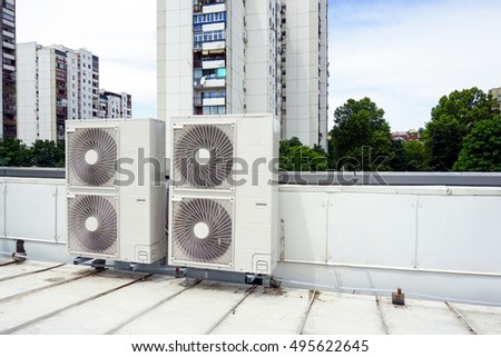 Air conditioning system assembled on top of a building. #495622645