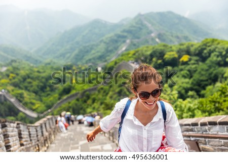 China travel at Great Wall. Tourist in Asia walking on famous Chinese tourist destination and attraction in Badaling north of Beijing. Woman traveler hiking great wall enjoying her summer vacation. Royalty-Free Stock Photo #495636001
