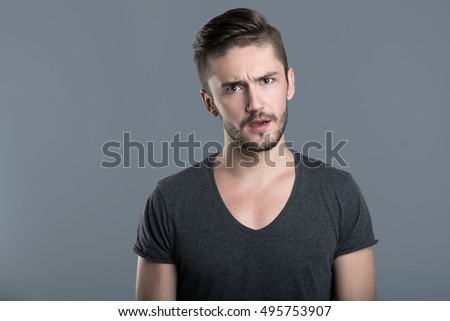 Puzzled young man opening mouth #495753907