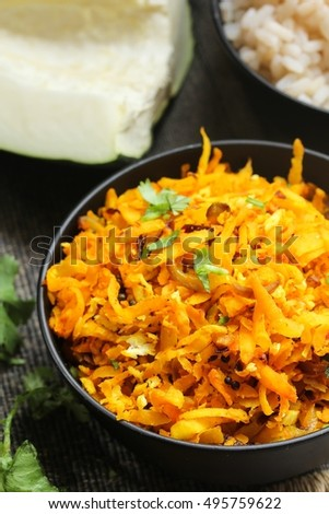 Papaya stir fry with turmeric and coconut, selective focus #495759622