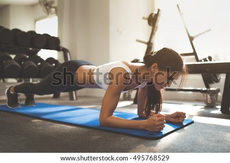 """Asian woman exercising in the gym, she was pretending to """"plank"""" Royalty-Free Stock Photo #495768529"""
