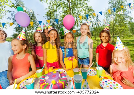 Funny kids at the outdoor birthday party #495772024