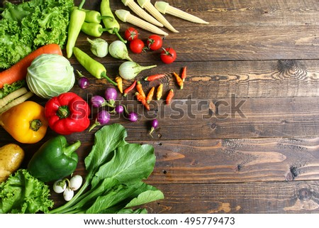 Include fresh organic vegetables basket on wooden floor with copy space still life #495779473