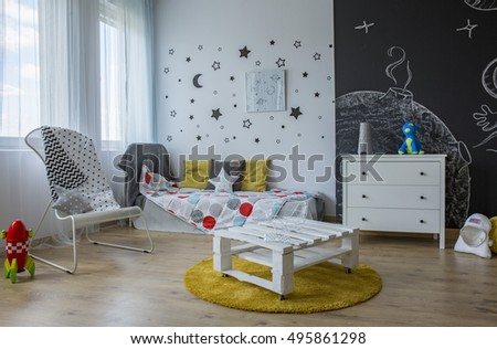 Spacious child room in contemporary style with stars on the wall and blackboard wall #495861298