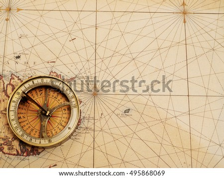Old compass over ancient map from XVIII century #495868069