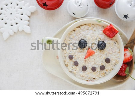 Snowman porridge oatmeal breakfast , Fun Christmas food art for kids #495872791