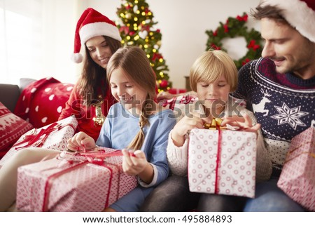 Kids start opening Christmas presents