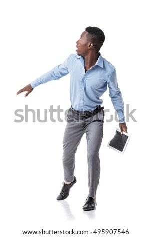 scared African-American businessman runs and looks around. isolated on white background. pressure on business #495907546