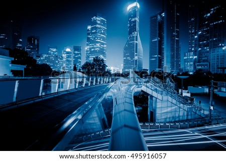 footbridge with cityscape at night in Shanghai,China. #495916057