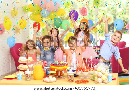 Children's funny birthday party in decorated room Royalty-Free Stock Photo #495961990