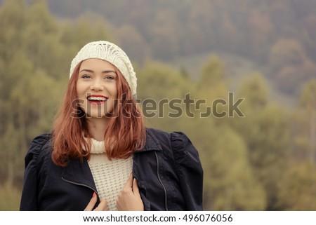 Beautiful portrait of a caucasian female in a autumn day #496076056