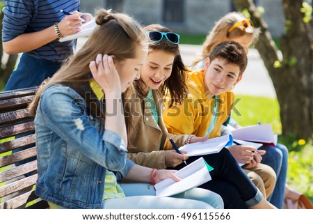 education, high school and people concept - group of happy teenage students with notebooks learning at campus yard Royalty-Free Stock Photo #496115566
