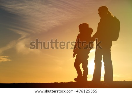mother and son travel at sunset #496125355