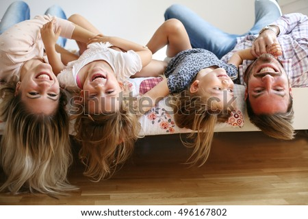 Family with two children having fun at home.  #496167802