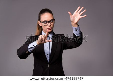 Young woman businesswoman pressing virtual buttons #496188967