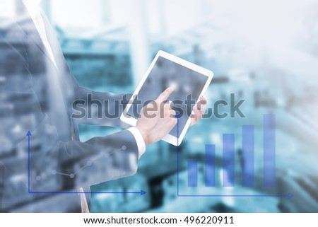 Double exposure of businessman using the tablet with business graph on blur image of  shopping department store , Management Information Technology concept #496220911