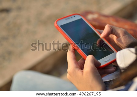 Teenage girl using smart phone with phone texting #496267195