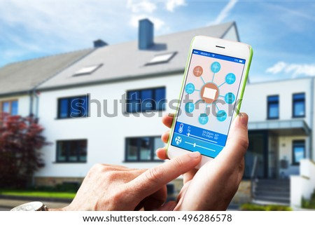 adjusting the room temperature with smart home home automation system #496286578