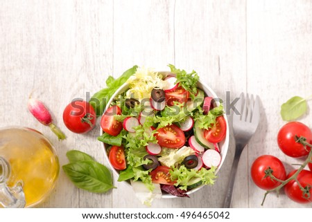 fresh salad with tomato and radish #496465042