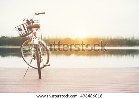 Vintage toned of bicycle with basket on empty pier, summer day. #496486018