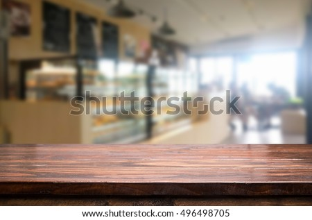 Selected focus empty brown wooden table and Coffee shop blur background with bokeh image. for your photomontage or product display #496498705