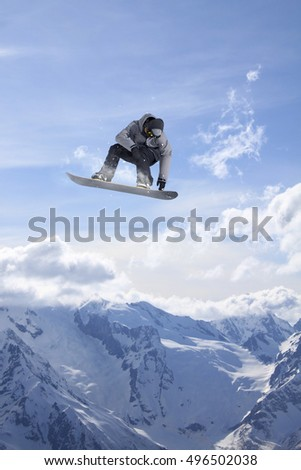Flying snowboarder on mountains. Extreme sport. #496502038