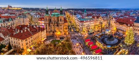 PRAGUE, CZECH REPUBLIC - DECEMBER 10, 2015: Panoramic city skyline, illuminated buildings and Christmas market on Old Town Square in Prague - popular destination with tourists on winter holidays. #496596811