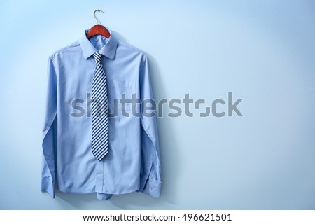 New male shirt on blue background