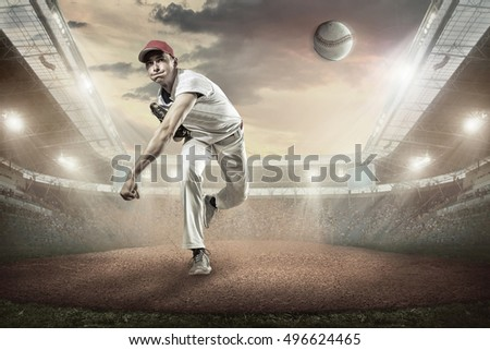 Baseball players in action on the stadium. #496624465