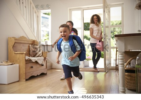 Excited Children Returning Home From School With Mother Royalty-Free Stock Photo #496635343