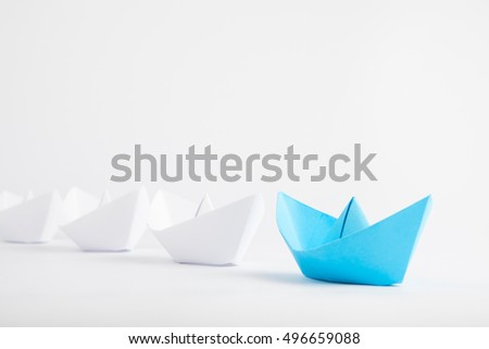 Leadership concept with blue paper ship leading among white #496659088