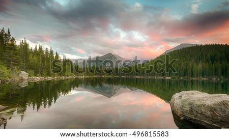 Longs Peak reflection in Bear Lake at dusk, in Rocky Mountain National Park, near Estes Park, Colorado. #496815583