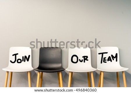 Job recruiting advertisement represented by 'JOIN OUR TEAM' texts on the chairs. One chair is colored differently to represent the hiring position to be recruited and filled. Royalty-Free Stock Photo #496840360