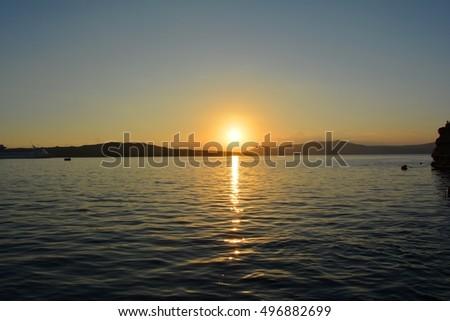 Sunset over the island. Greece. Santorini. #496882699