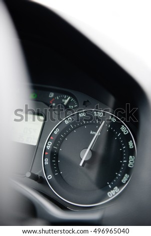 Car speedometer close-up with the needle pointing a high 130 km/mph speed, blur effect and blue tone to depict high speed concet and security driving electric car #496965040