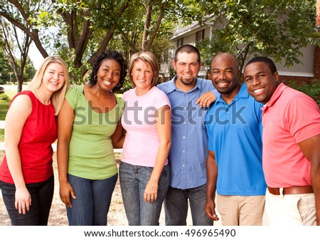 Diverse group of friends. Multicultural people smiling. Friends smiling and laughing. #496965490