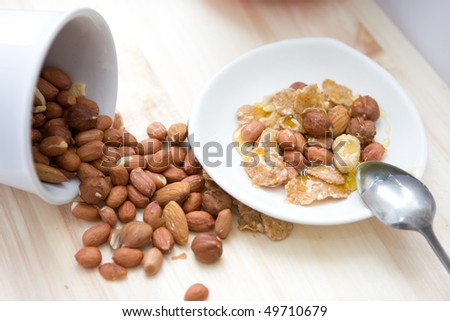 Healthy meal.Mix of nuts with honey #49710679