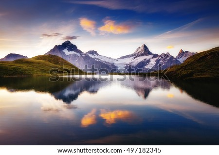 Alpine view of the Mt. Schreckhorn and Wetterhorn. Popular tourist attraction. Dramatic and picturesque scene. Location place Bachalpsee in Swiss alps, Grindelwald valley, Europe. Beauty world. #497182345