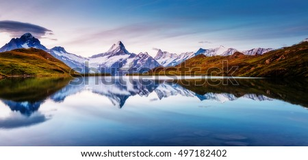 Panoramic view of the Mt. Schreckhorn and Wetterhorn. Popular tourist attraction. Dramatic and picturesque scene. Location place Bachalpsee in Swiss alps, Grindelwald valley, Europe. Beauty world. #497182402