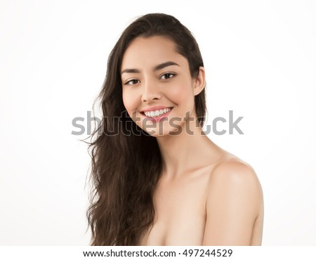 Beauty Woman face Portrait. Beautiful Spa model Girl with Perfect Fresh Clean Skin. Brunette female looking at camera and smiling. Youth and Skin Care Concept  #497244529