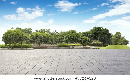 Empty tiles at the nice and peaceful comfortable great garden panorama under lovely blue sky #497264128