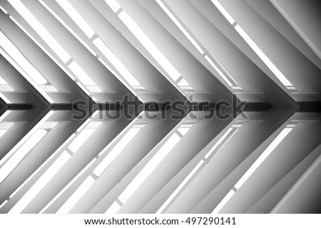 Lath ceiling. Construction of roof. Joist, rafter. Abstract contemporary architecture or modern interior photograph. Geometric pattern with regular angular structure.