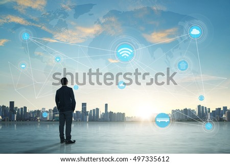 International business concept with businessman on city skyline background with network on map and sunlight #497335612