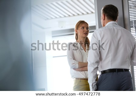 Businesswoman and business man having a very serious conversation in the office  #497472778